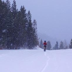 Norman climbs to Garnet on his snow bike