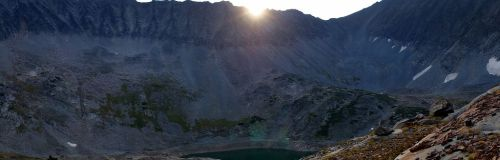 Sun cresting the crown of Rock Lake