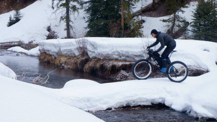 Bill crossing snow bridge