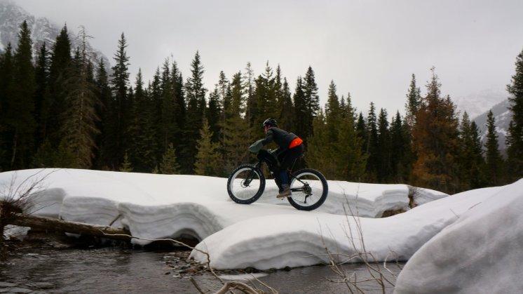 Mo crossing snow bridge