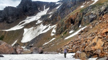 Mo walking the snowfield between Triangle and Sheep lakes
