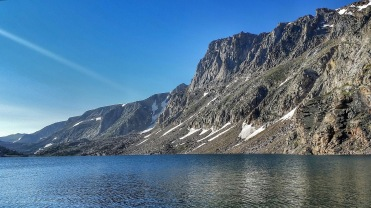 Glacier Lake is surrounded by cliffs