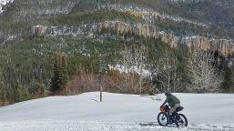 I negotiate some snow machine tracks on the decent.