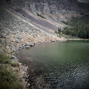 Rock walls surrounds the lake