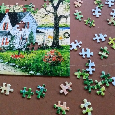 Snuggles spent some quality time working on a puzzle.