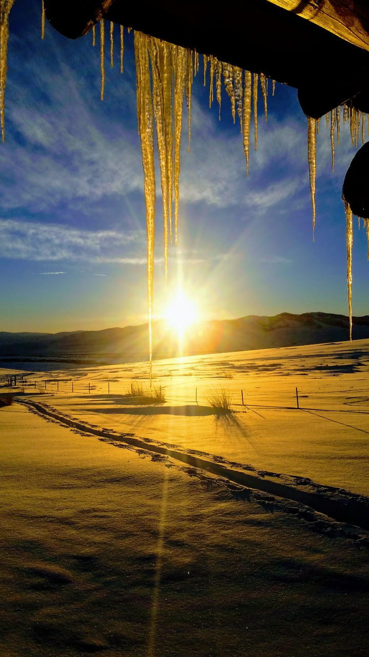 The sun hitting the icicles from the roof