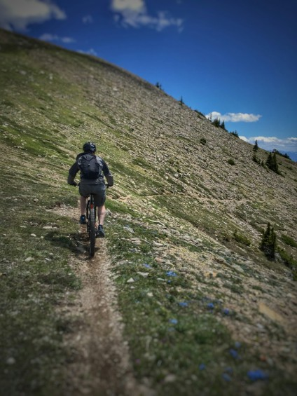 Bill heading down the trail from Sacagawea Pass.