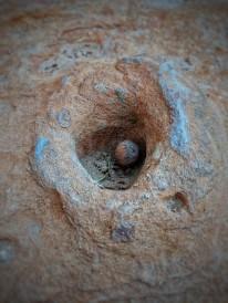 Waterhole with a rock
