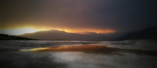 Storm sandwiching the sunset and earth